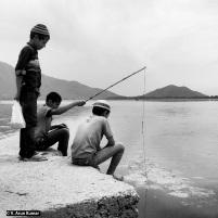 Everydaylife: Children fishing during shutdown (location: Dal Lake, Srinagar)